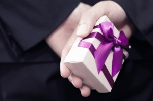 Image of businessman with a gift